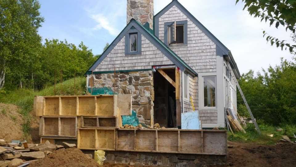 Building a wood shed using slipform stone masonry