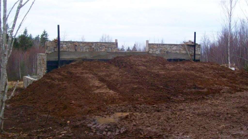Berm wall backfilled