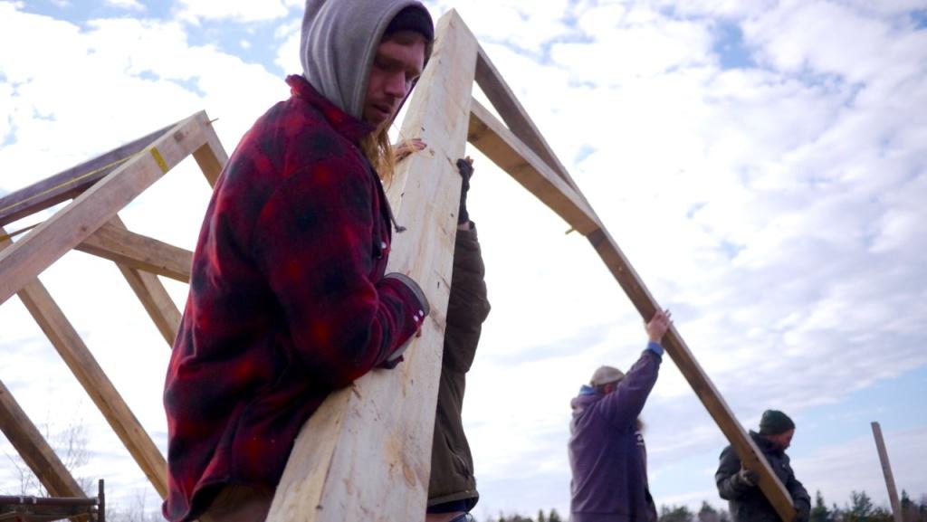 Raising a truss