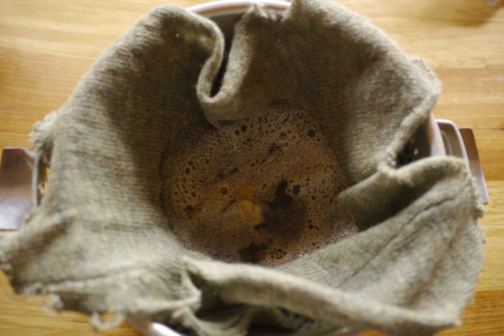 Filtering syrup through old wool sweater