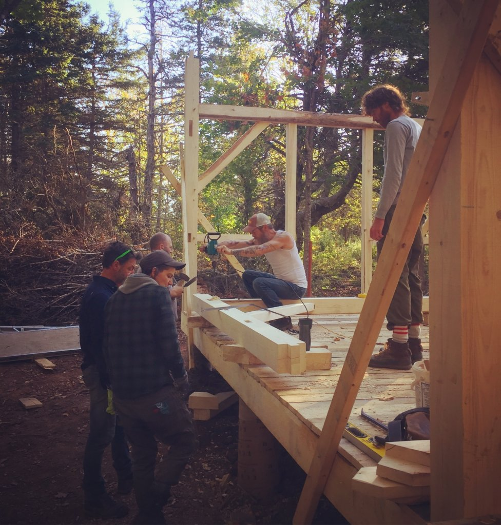 Getting togheter to raise the walls of Sally's cabin