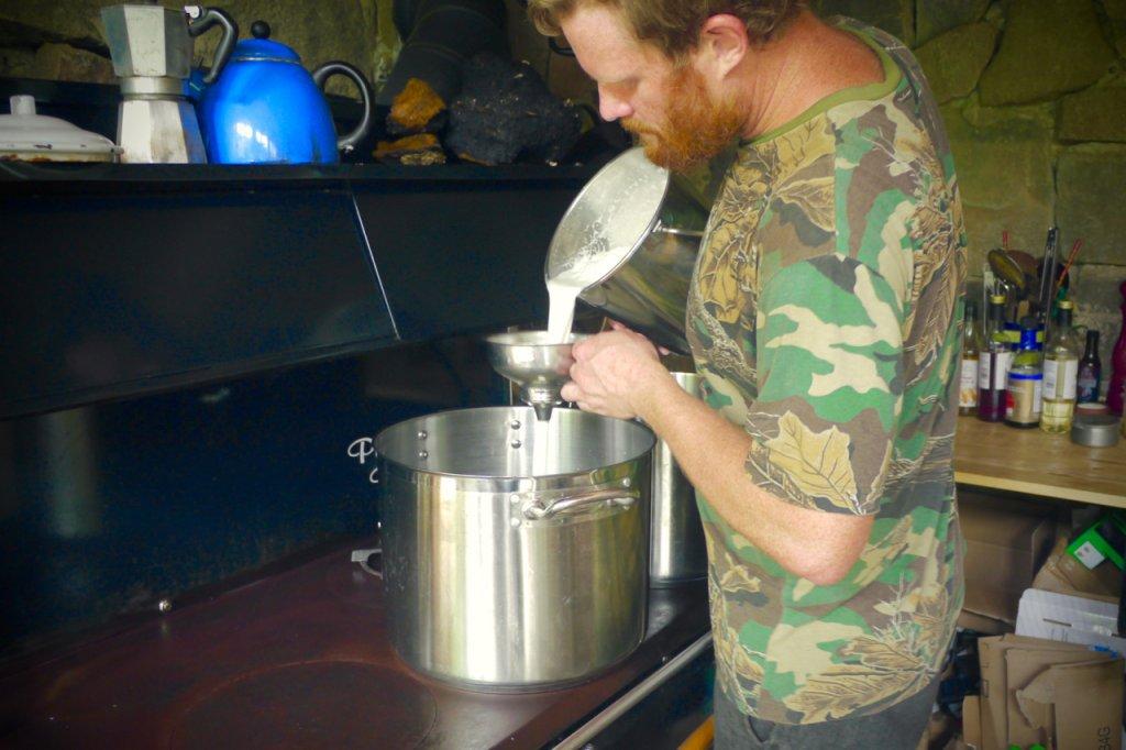 Adam filtering the milk